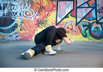 breakdancing - Young woman breakdancing