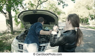 Breakdown of the car on the road. The daughter gives a...