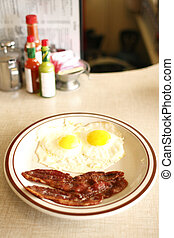 Breakfast - A breakfast consisting of eggs sunnyside up and ...