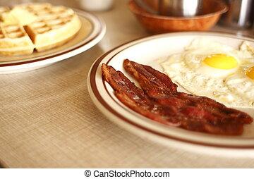 Breakfast - A breakfast consisting of eggs sunnyside up, ...