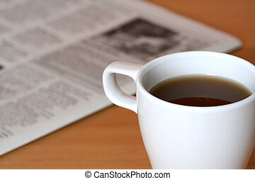 Breakfast - A cup of coffee and a newspaper