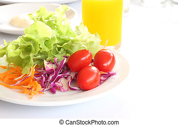 Breakfast and salad on morning table.