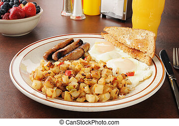 Breakfast at the diner - A healthy breakfast of sausage,...