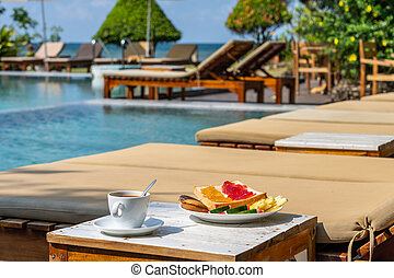 Breakfast at the swimming pool on summer vacation