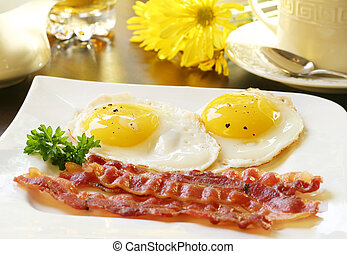 Breakfast - Bacon and eggs, sunny side up.
