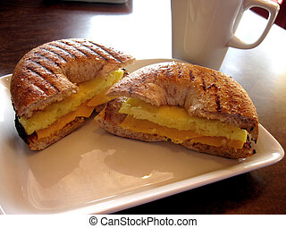 Breakfast Bagel - Egg and cheese on a wholewheat bagel with ...
