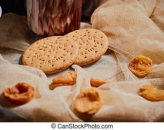 Breakfast. Biscuits and dried apricots