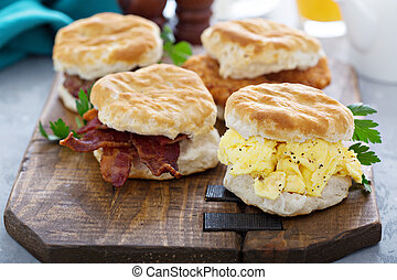 Breakfast biscuits with soft scrambled eggs and bacon -...