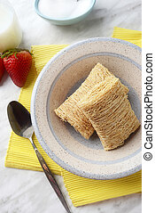 breakfast bowl of shredded wheat with strawberries