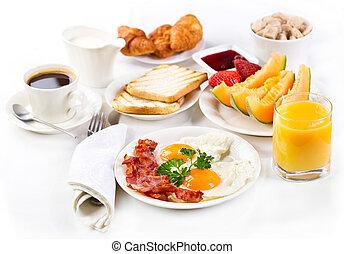 breakfast - Breakfast with fried eggs, coffee, orange juice...