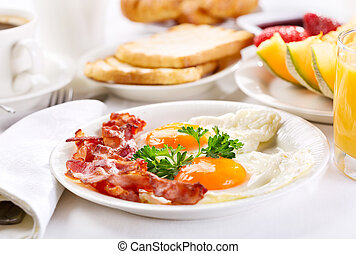 breakfast - Breakfast with fried eggs, coffee, orange juice,...