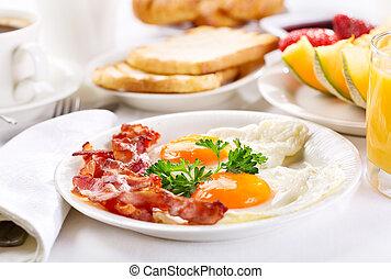 breakfast - Breakfast with fried eggs, coffee, orange juice,...