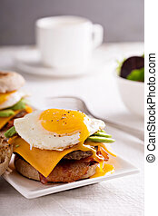 Breakfast burger with avocado, cheese and bacon