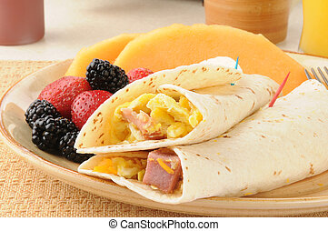 Breakfast burrito - A breakfast burrito with fresh berries...