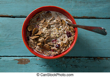 Breakfast cereal in bowl on wooden table