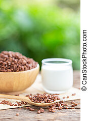Breakfast cereal, Puffed rice with cocoa in bowl and glass of milk on wooden table