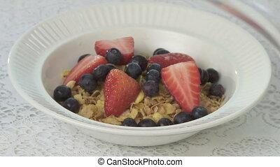 Breakfast Cereal - Preparing a bowl of breakfast cereal