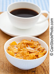 Breakfast cereal with a black coffee
