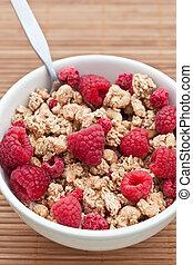 Breakfast cereal with fresh rapsberries