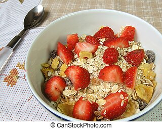 Breakfast cereals - A bowl of granola and strawberries on a ...