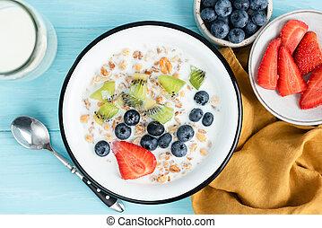 Breakfast cereals with milk and berries