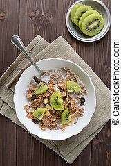Bowl with corn flakes and kiwi for nourishing breakfast