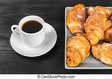 Breakfast concept, Cup of coffee and croissants