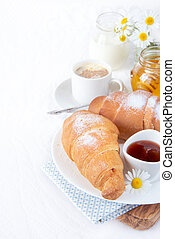 Breakfast - Continental breakfast with croissant, cup of...