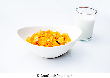 corn flakes with glass of milk