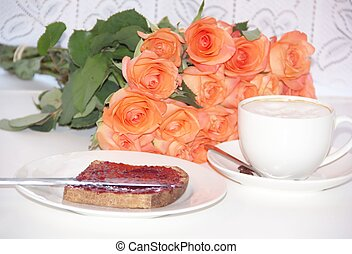 Breakfast - cup of coffee and a toast with strawberry jam