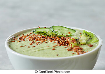 Breakfast detox green smoothie from cucumber and kiwas, close up