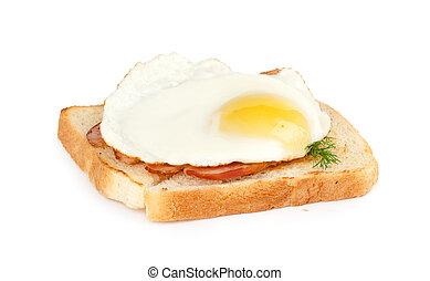 Breakfast. Eggs, bacon and toast