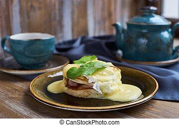 Breakfast. Eggs Benedict and tea.