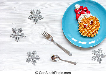 breakfast for child on Christmas with waffle top view