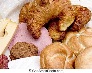 Breakfast, fresh bread, cheese and meat. - Breakfast table ...