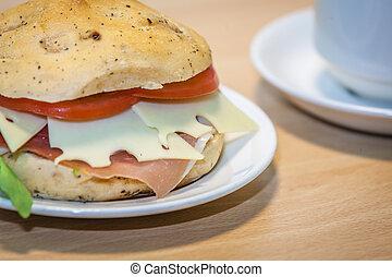 Breakfast ham, cheese and tomato bun