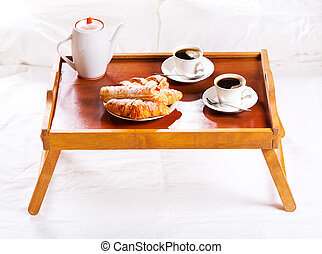 Breakfast in bed. Tray with coffee and pastry