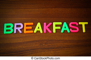 Breakfast in colorful toy letters