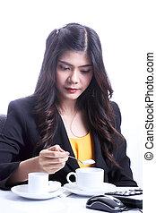 Breakfast in office woman