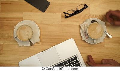 Breakfast in the cafe two business men