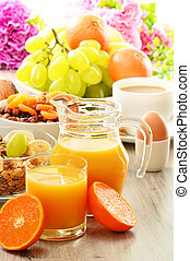 Breakfast including coffee, bread, honey, orange juice, muesli and fruits