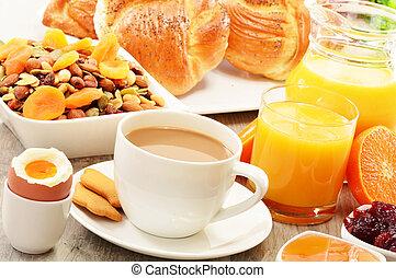 Breakfast including coffee, bread, honey, orange juice,...