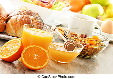 Breakfast including coffee, bread, honey, orange juice, muesli and fruits