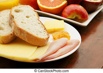 Breakfast Meal with Bread Ham and Cheese