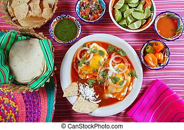 Breakfast Mexican ranchero eggs with chili and nachos Mexico...