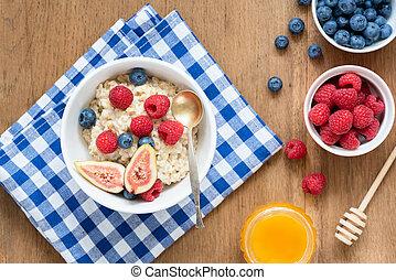 Breakfast Oatmeal Porridge WIth Fruits Berries Honey