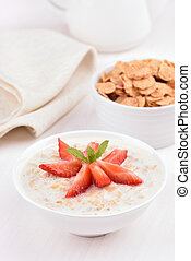 Oatmeal porridge with strawberry slices