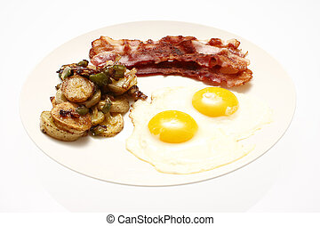 Breakfast of eggs sunnyside up, strips of bacon, and ...