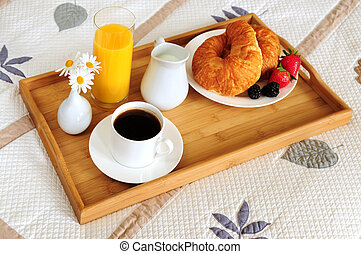 Breakfast on a bed in a hotel room - Tray with breakfast on ...
