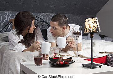 Breakfast on a table with couple lying